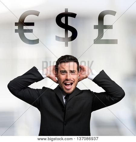 Desperate businessman in front of Euro, Dollar and Pound signs