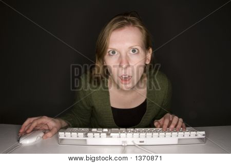 Shocked Woman Viewing Computer Monitor