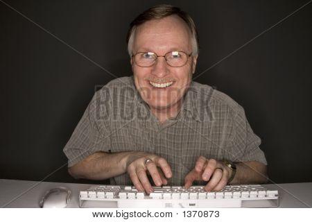 Happy Man Viewing Computer