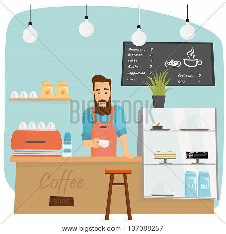 Trendy bearded barista making coffee in coffeeshop.