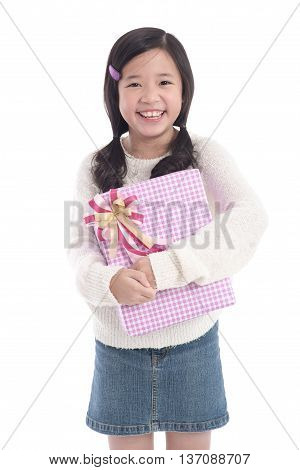 Beautiful asian girl holding a present on whit background isolated