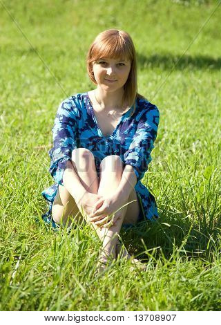 Girl Sitting On Meadow
