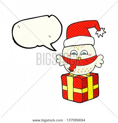 freehand drawn comic book speech bubble cartoon cute christmas owl on wrapped present