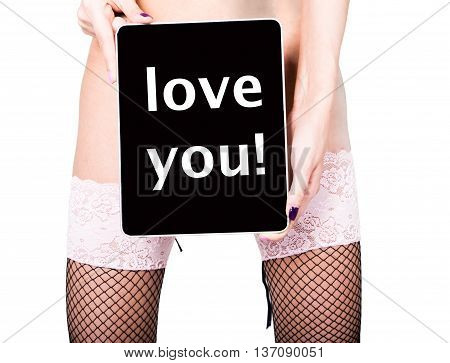 technology, internet and networking - close-up ass of girl in lacy lingerie, holding a tablet pc love you sign. Adult content, young woman holding aq gift.