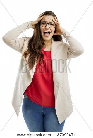 Portrait of a stressed woman with hands on head and yelling