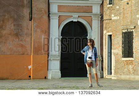 young woman tourist on the island of burano near Venice in Italy