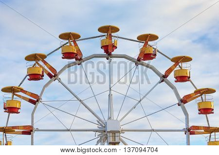 Ferris wheel in the park amusement with blue sky in background