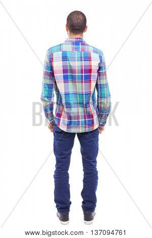 Back view of young man with the hands on the pockets, isolated on white background