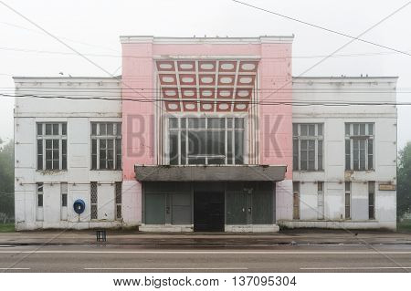 Abandoned cinema in Orel Russia in morning haze with empty chair in front horizontal