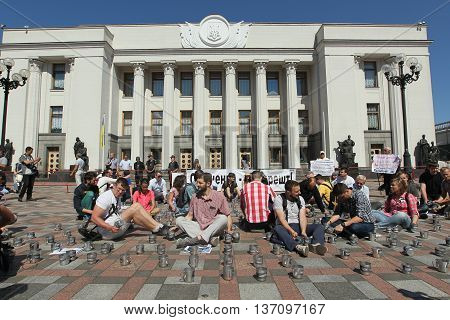 Kiev Ukraine - July 5 2016: Public activists rattling the cups of prison to parliament voted for arrest an escaped politician Alexander Onishchenko in Russia near the building of the Verkhovna Rada of Ukraine