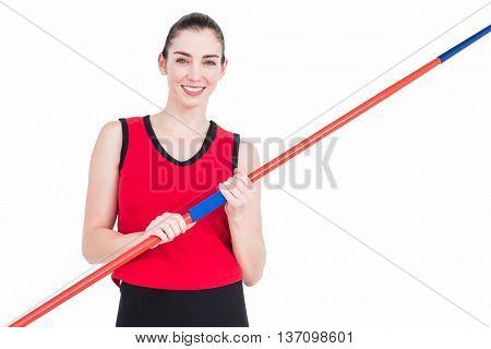 Female athlete holding a javelin on white background