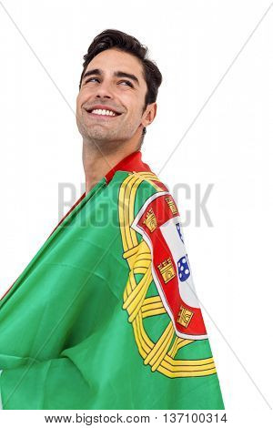 Male athlete posing with portugal flag wrapped around his body on white background
