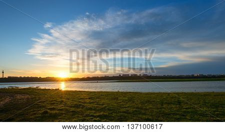 sunset on danube in spring time .