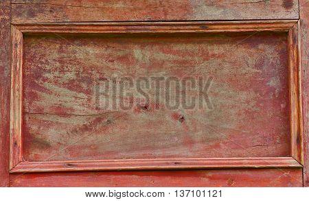 Vintage red wood sideboard door. old background
