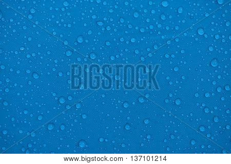 Blue bubbles on fabric surface. background .