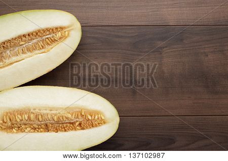 pieces of sweet melon on the wooden table