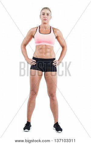 Female athlete posing with hands on hip on white background