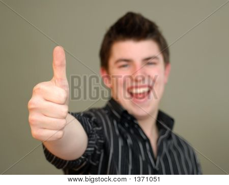 Casual Young Man Giving Thumbs Up