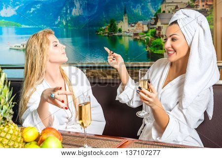 female communication after spa treatments in the sauna