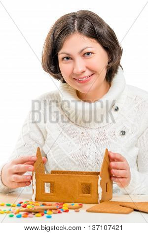 Portrait Of Young Woman Decorating A Gingerbread House