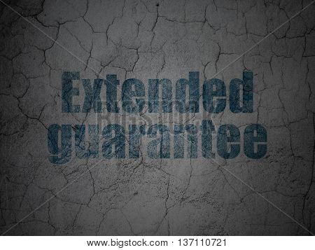 Insurance concept: Blue Extended Guarantee on grunge textured concrete wall background