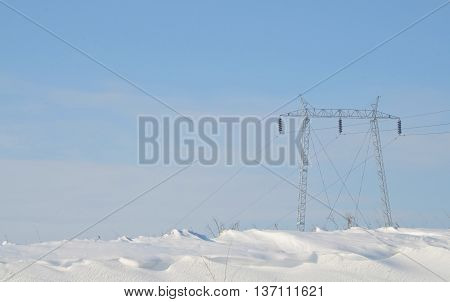 Power distribution, high voltage power pole in winter