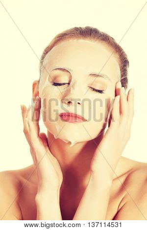 Beautiful caucasian woman with collagen mask.