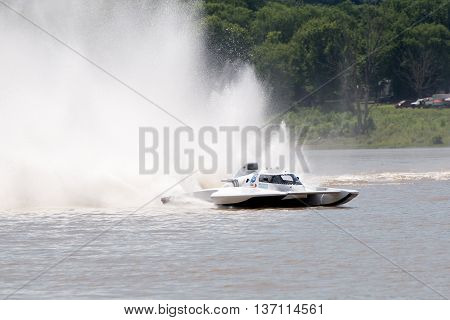 Madison Indiana - July 2 2016: Scott Liddycoat drives the Magnum Racing GNH 18in the Grand National Hydroplane Qualification Heat #1 at the Madison Regatta in Madison Indiana July 2 2016.