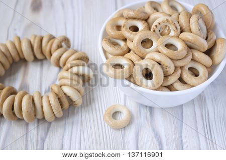 Wooden rustic table with national russian bagels. A group of bagels on a wooden table