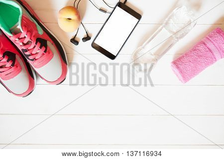 Red Sneakers With Towel, Peach, Bottle With Water, Smartphone With Copy Space On Screen With Headpho