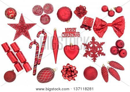 Red christmas tree bauble decorations over white background.