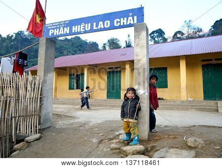 LAO CAI, VIETNAM, March 17, 2016 Hmong children, highland, Lao Cai, standing by school, elementary