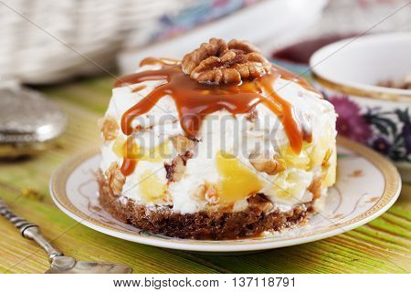 cake with sour cream whipped boiled condensed milk pineapple walnuts chocolate biscuit still life