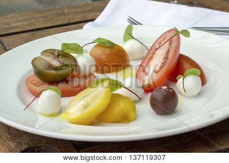 Heritage tomato salad with bocconcini and herbs