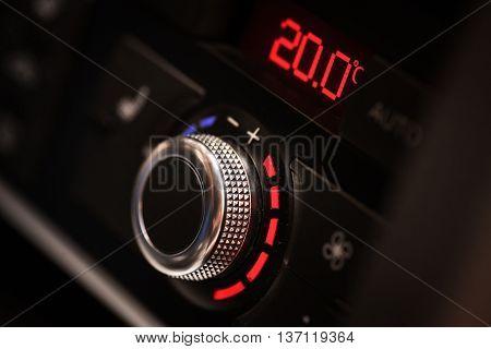 Close up shot of a car's air conditioner adjustment knob.
