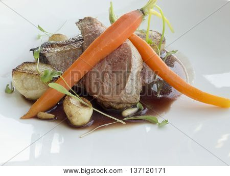 Wild duck with Baby carrots & turnips