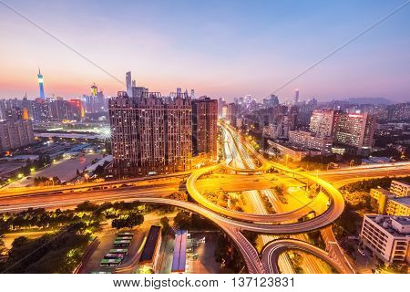 city interchange in guangzhou bright lights and traffic in sunset