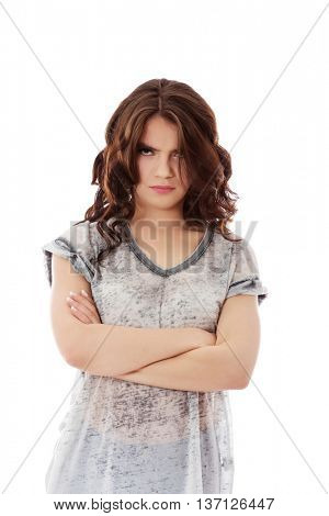 Young angry woman with crossed arms