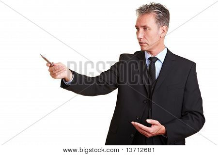 Senior Business Man Pointing With Pen