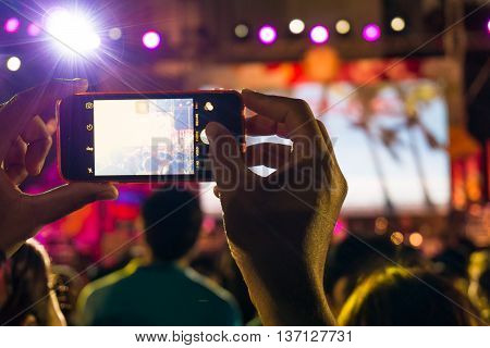Blurred People Holding Their Smart Phones And Photographing Concert