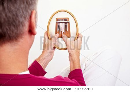 Hands Playing A Kalimba