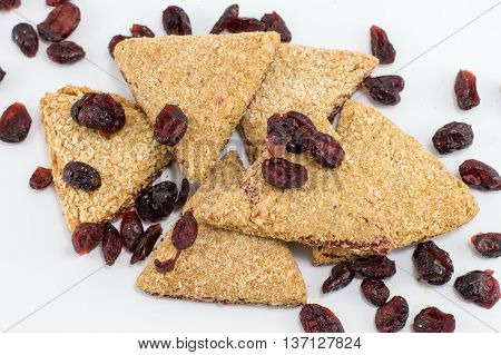 Integral Triangle Cookies With Raisins On White