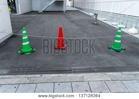 Traffic warning cone in row to separate route