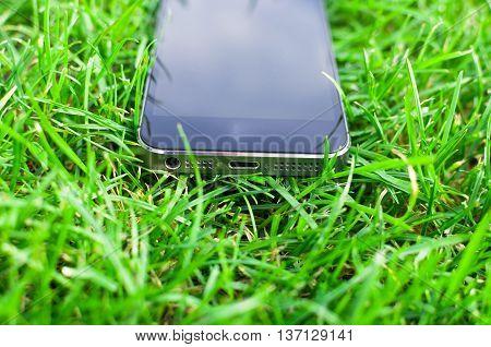 Black Phone detail on freshly cut grass