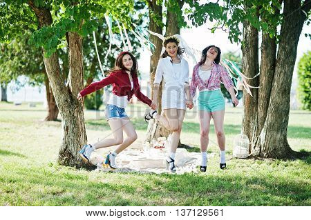 Three Cheerful Beautiful Girls In Short Shorts Jumping Background Decoration At Bachelorette Party
