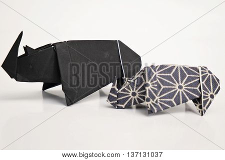 A big and a small rhinoceros origami with white background