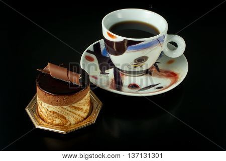 Chocolate Pastry On Black Background With Cup Of Coffee