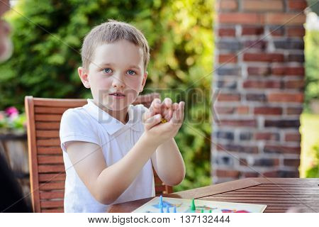 Little Boy Playing Ludo Board Game