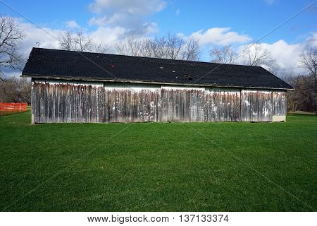An abandoned 19th century farm shed stands in the Plainfield Park District's Eaton Preserve in Plainfield, Illinois.