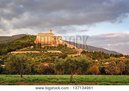 Assisi (Umbria) at sunset and basilica di san francesco